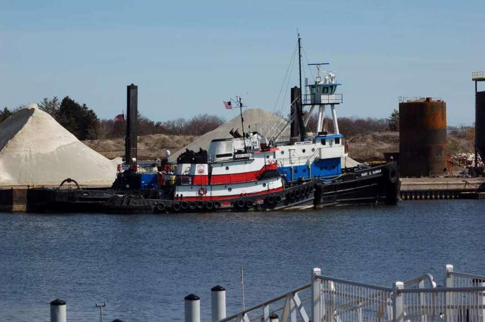 Tugboats moored together