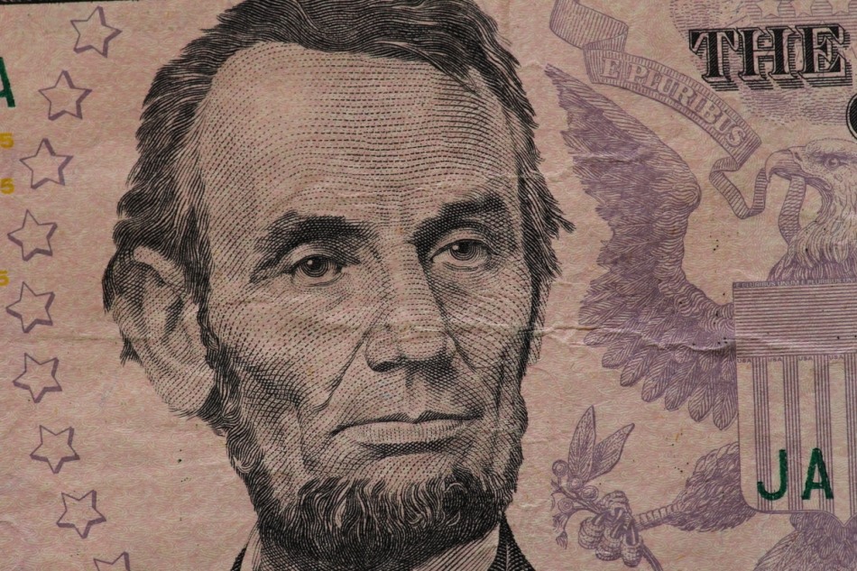 Abe from a five dollar bill