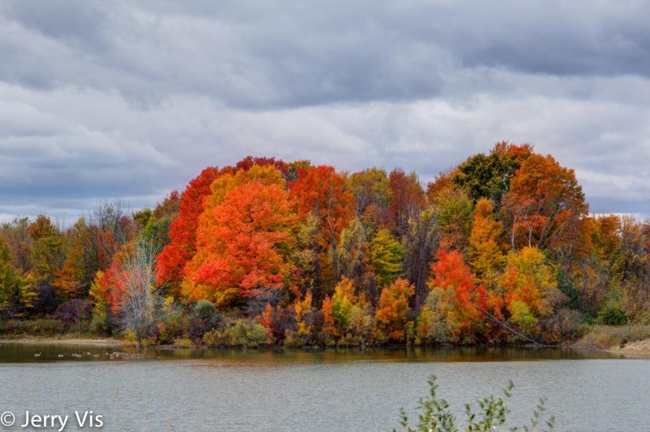 Fall colors across a small Michigan lake