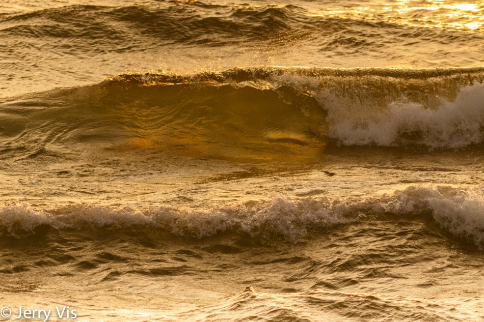 Waves breaking near sunset