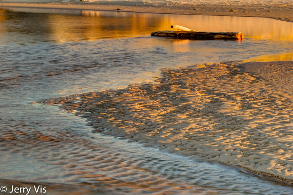 Patterns in the sand at sundown