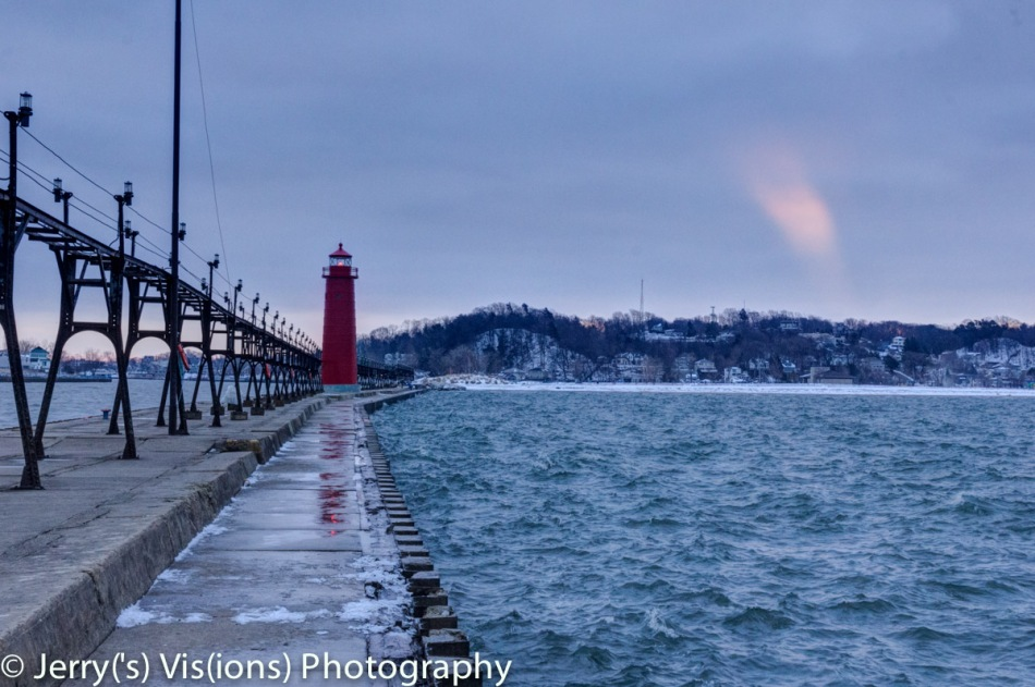 Just after sunrise on the Grand Haven breakwater