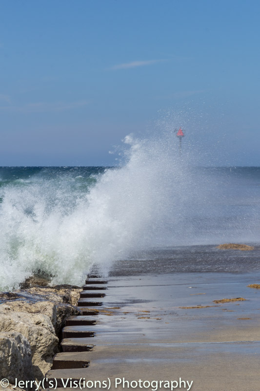 Waves breaking over the breakwater at White Lake